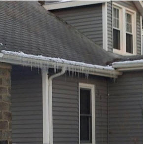 icicles on a roof - first sign of an ice dam