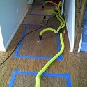 water damage to hardwood floors saved with our mat drying system