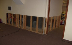water damage restoration process: removing damaged drywall Cherry Hill, NJ