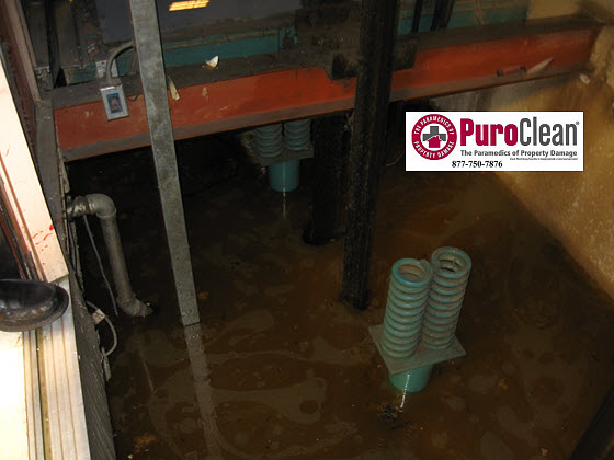 commercial water damage restoration: flooded elevator pump out