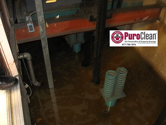commercial water damage restoration: flooded elevator pump out