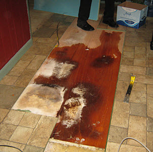 Levittown water damage from radiant heat system in floor
